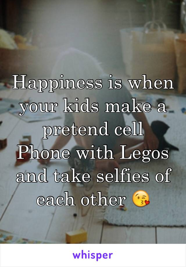 Happiness is when your kids make a pretend cell Phone with Legos and take selfies of each other 😘