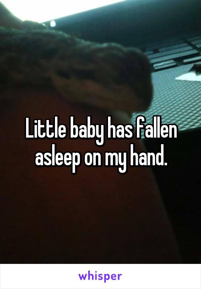 Little baby has fallen asleep on my hand.